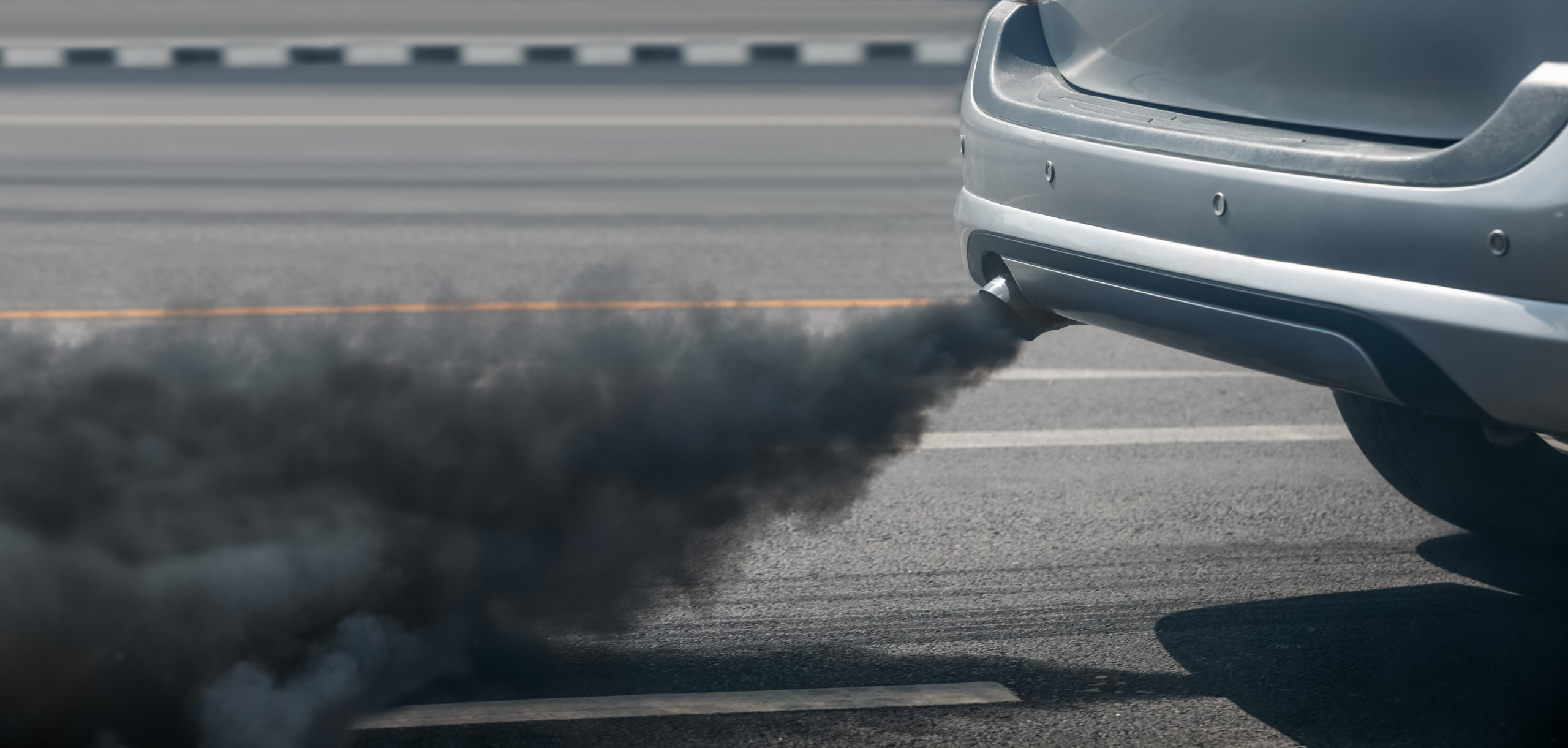 air pollution crisis in city from diesel vehicle exhaust pipe on
